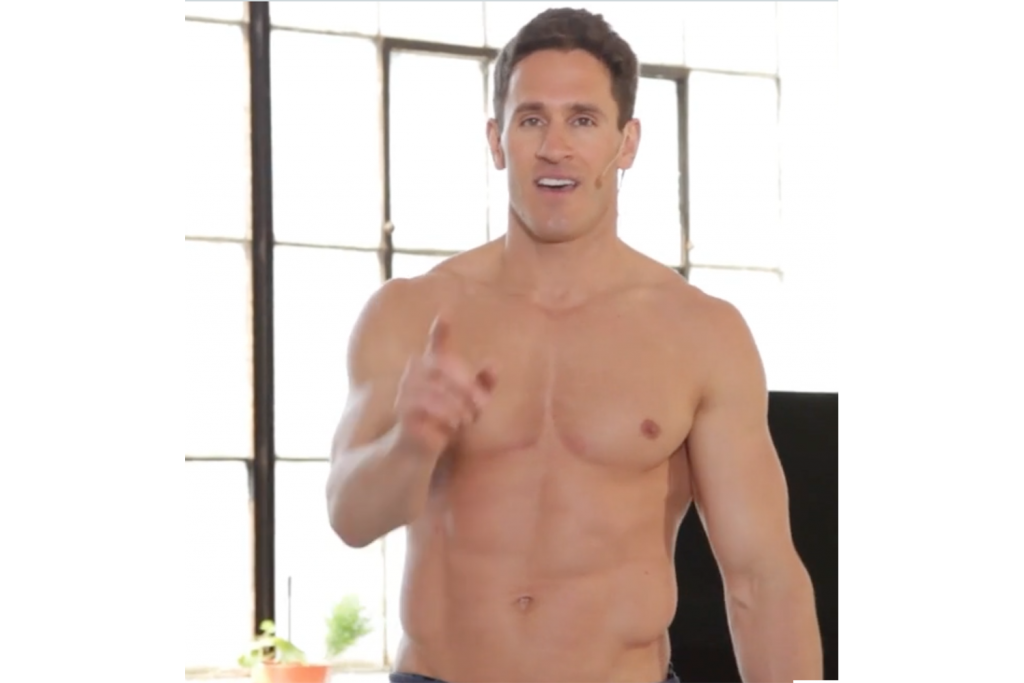 shirtless guy with muscular body pointing as if about to say something