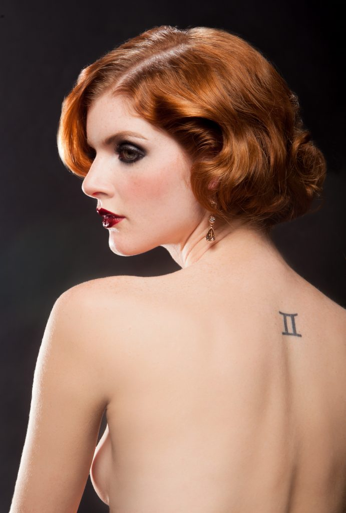 Red-head model with dark flapper makeup and back tattoo , shot by Marcin Mujalski