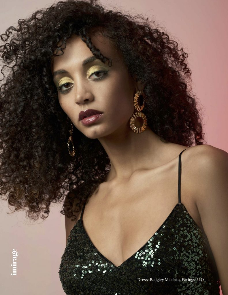 Two shots of model with gorgeous spiral curls and beautiful professional makeup