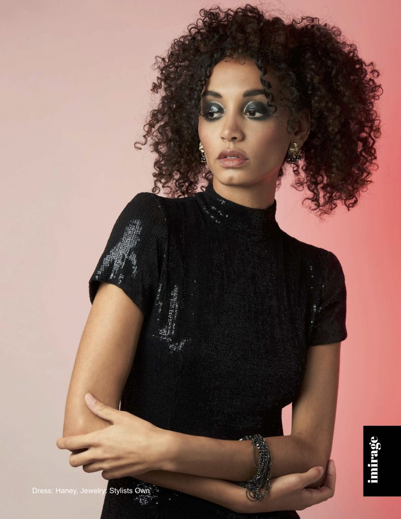 model with gorgeous spiral curls and beautiful professional makeup
