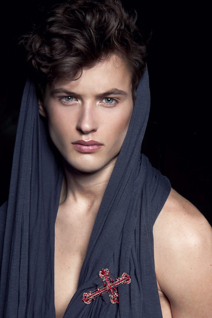 Young male model with perfect skin shot by Sailey Williams
